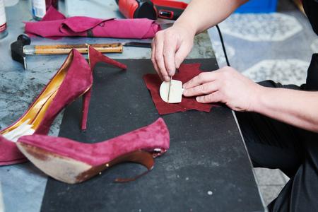 Shoemaker repair female shoe. Reklamní fotografie