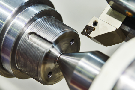 turning cnc machine at metal work industry. Precision manufacturing and machining
