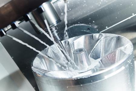 Milling machine work. Metalwork industry. CNC processing aluminium alloy detail