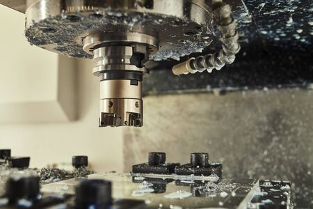 cnc machine at metal work industry. Milling precision manufacturing and machining