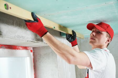 gypsum suspended ceiling construction work. quality control Stock Photo