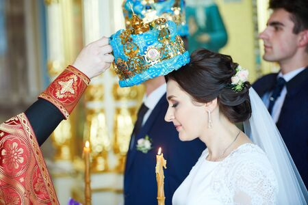 Groom and bride on the wedding ceremony in orthodox church