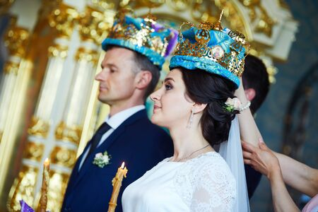 Groom and bride on the wedding ceremony in the church