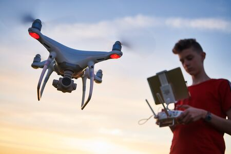drone flying. copter pilotage at sunset Stockfoto