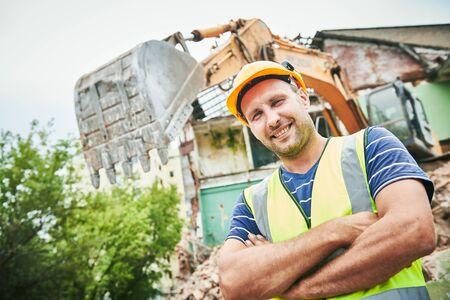 Demolition construction work. Worker at building site Stockfoto