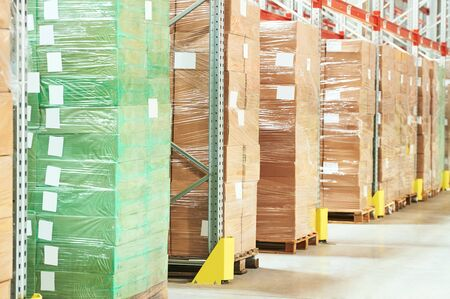 Row of package boxes in modern warehouse