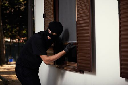 break-in of an apartment. Thief in mask
