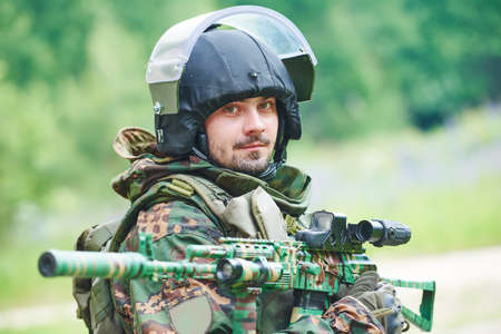 Military soldier portrait with machine gun and protective clothing Stock Photo