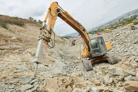 hydraulic breaker excavator at demolition work of reinforced concrete structures at construction site Stock fotó