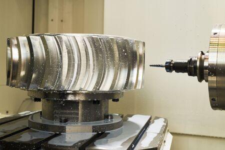 CNC milling machine work. cogwheel metalwork industry Banco de Imagens