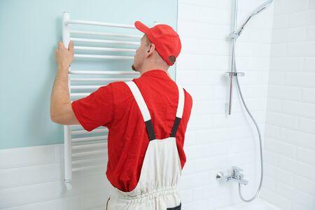 plumber service. handyman installing heating radiator Stock fotó