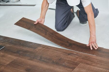 worker joining vinyl floor covering at home renovation Stock fotó