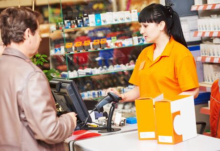 assistant cashier works with buyer shop Фото со стока - 131856270