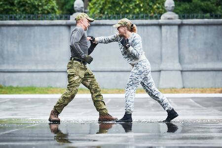 hand to hand combat between military instructor with female trainee Banco de Imagens - 131856576