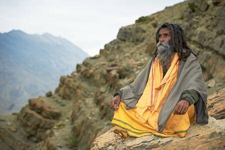 Indian monk sadhu at meditation in mountains