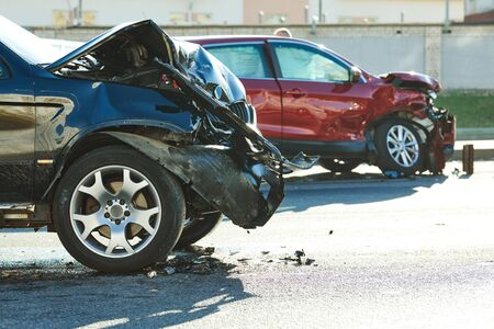 car crash accident. Car collision on city street. Two damaged automobiles 版權商用圖片