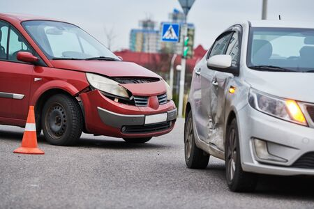 car crash accident. Car collision on city street. Two damaged automobiles Stock Photo