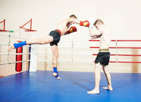 Muay thai sportsman fighting at boxing ring