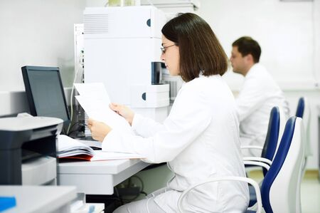 Pharmaceutical scientific female researcher analyzing liquid chromatography data at pharmacy industry manufacture factory laboratory Stok Fotoğraf