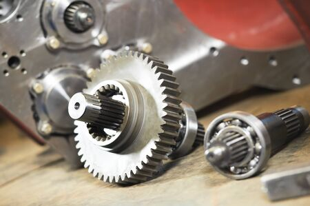 Gear box production. metal cog wheels gears and shaft with rolling bearings Stok Fotoğraf