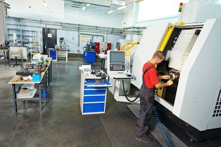 manufacture technician worker at factory metal machining shop Imagens