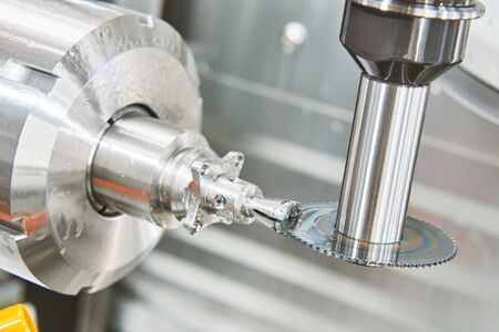 industrial metalworking machining cutting process of blank detail by saw milling cutter at modern CNC machine Stok Fotoğraf