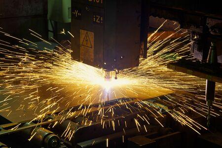 Laser or plasma cutting technology of flat sheet metal. Stok Fotoğraf