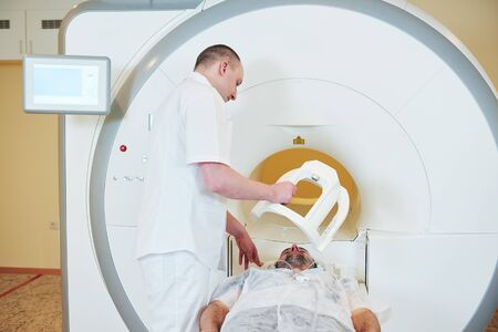 male patient undergoing MRI - magnetic resonance imaging or computed tomography in hospital Stock Photo