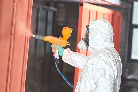 polymer coating of metal detail with powder spraying gun