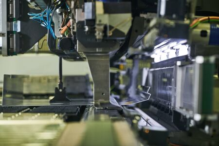 Panel bending machine at work. process of metal sheet forming
