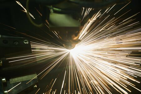 Laser cutting. Metal machining with sparks