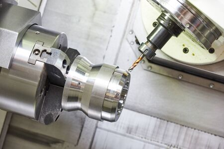metalworking industry. drilling a hole on modern metal working machining center Imagens