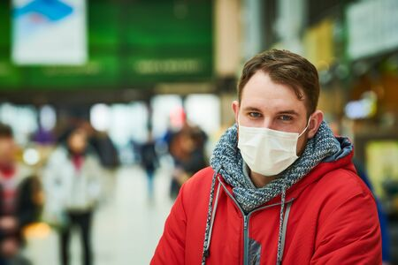 man with face mask at public place. coronavirus outbreak Stock Photo