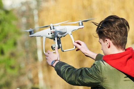 drone flying. Young man with copter outdoors