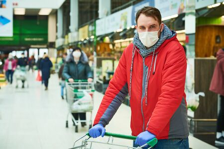 man with face mask at shopping center. coronavirus outbreak