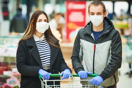 man and woman with face mask at shopping center. coronavirus outbreak