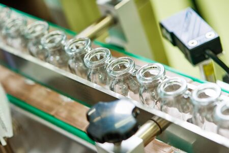 pharmaceutical production line at factory Stock Photo