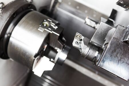 metal working CNC machining. Cutting tool during detail turning at factory Standard-Bild