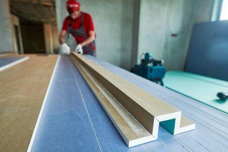 plasterboard work. worker assembling gypsum drywall construction