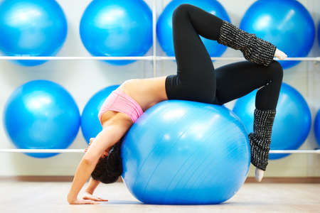 stretching pilates exercises with fitness ball