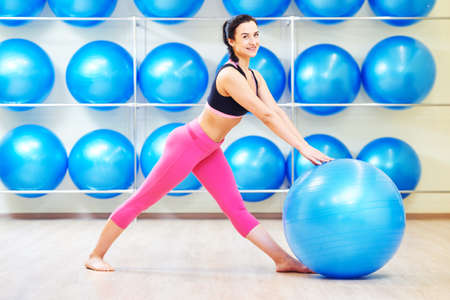 woman doing exercise with fitness ball Standard-Bild