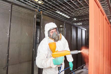 polymer coating of metal detail with powder spraying gun Stok Fotoğraf