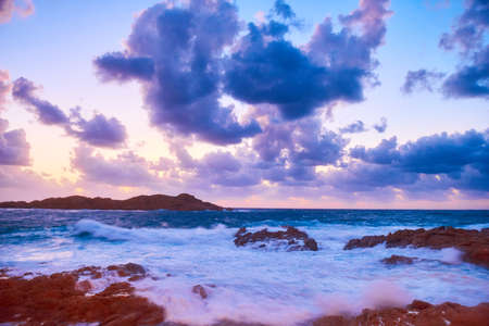 Scenic sunset over sea with waves