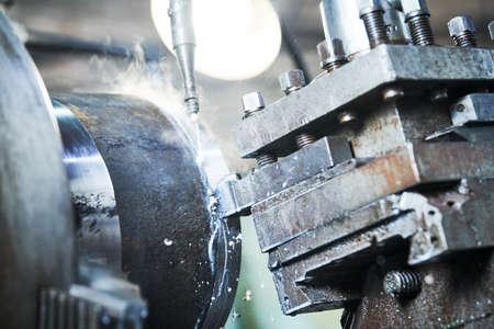 Cutting tool turning metal detail.