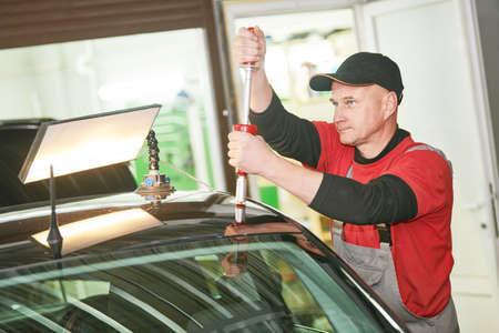 paintless dent repair of the car roof. Automobile service