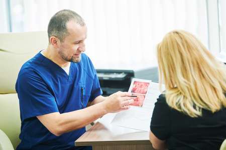 ultrasound scan explanation. Doctor interpreting test results to female patient