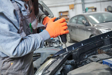 Worker assembling car body Stock Photo