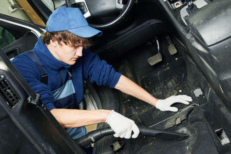automobile detailing. Car carpet cleaning with vacuum cleaner Stock Photo