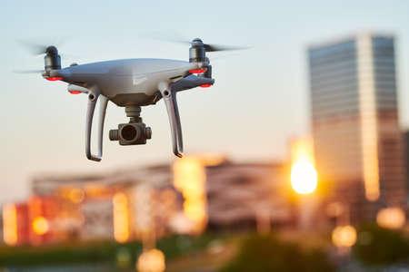 drone with digital camera flying at city street Reklamní fotografie
