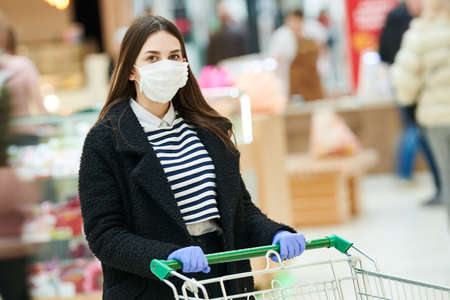 woman with face mask at public place. coronavirus outbreak Stock Photo